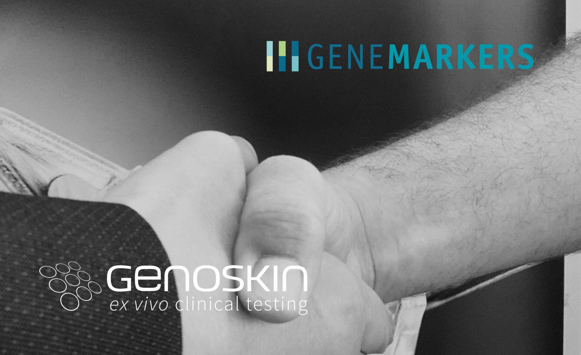 Two people shakings hands illustrating Genemarkers and Genoskin partnership